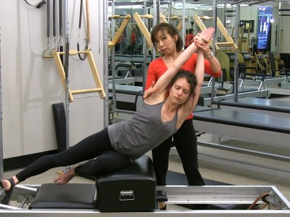 How to Do Side Sit Ups on the Reformer