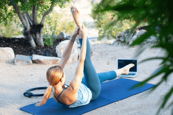 person doing pilates outdoors